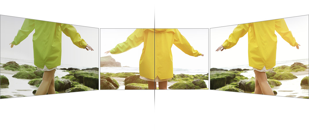 There are 3 TVs; one is placed on the front screen and others are obliquely on the left/ right sides. Based on the front, we can see others TVs in the left side and QLED TV in the right side. Yellow raincoat is indicated as dark and green one on others TVs, but it is shown clear and vivid yellow one on the QLED TV.