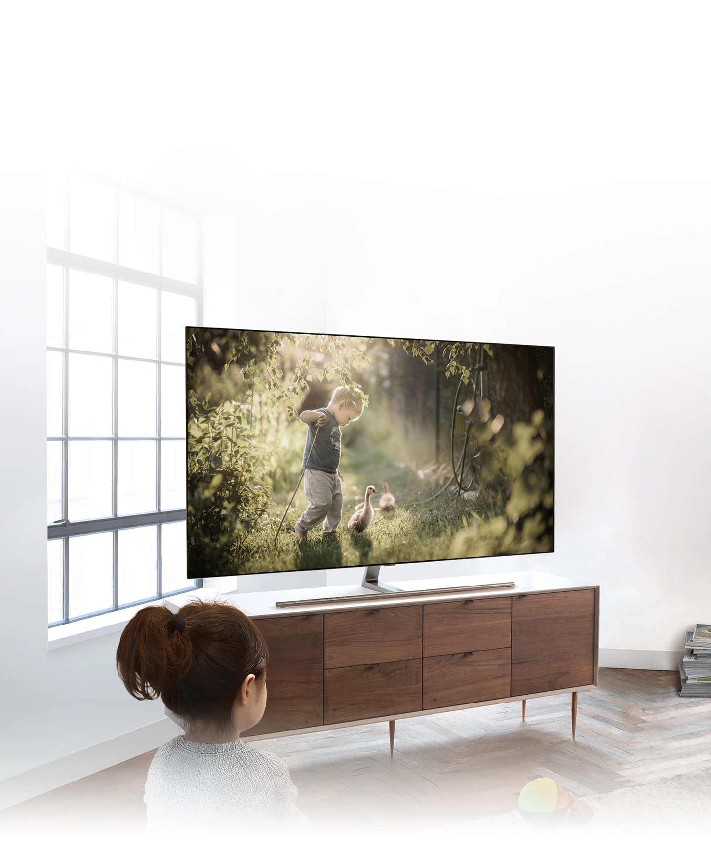 It shows a girl's image and she is watching QLED TV in flank.