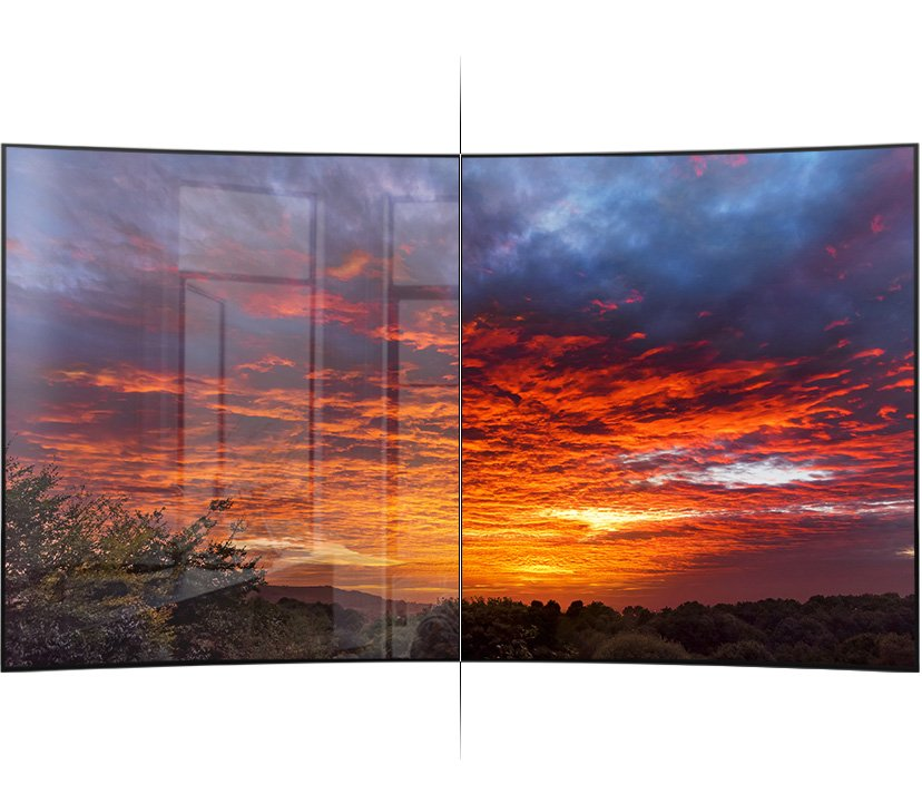 The front-placed TV has been divided in half. One side shows an image of vivid and bright sunsets by absorbing light even though another side displays an image of blurred sunsets by reflecting light.